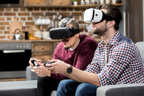 two men playing virtual reality video game